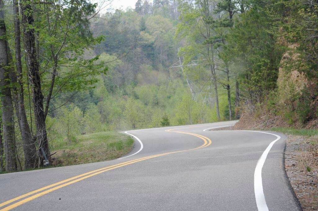 A tranquil ribbon of road. The only thing missing is the whine of turbo in second gear, the revs of the engine, and the tires sticking to the road. No squealing, just gripping.
