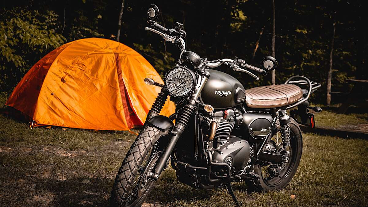 Motorcycle in front of a tent