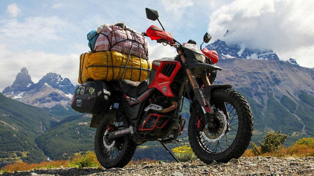 Red motorcycle loaded with bags