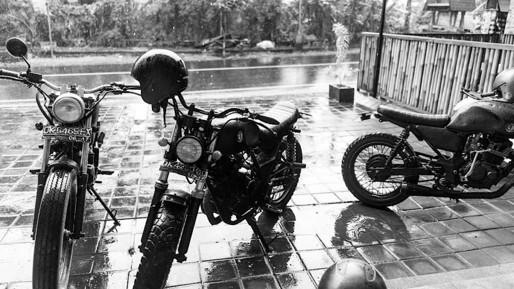 3 motorcycles in the rain
