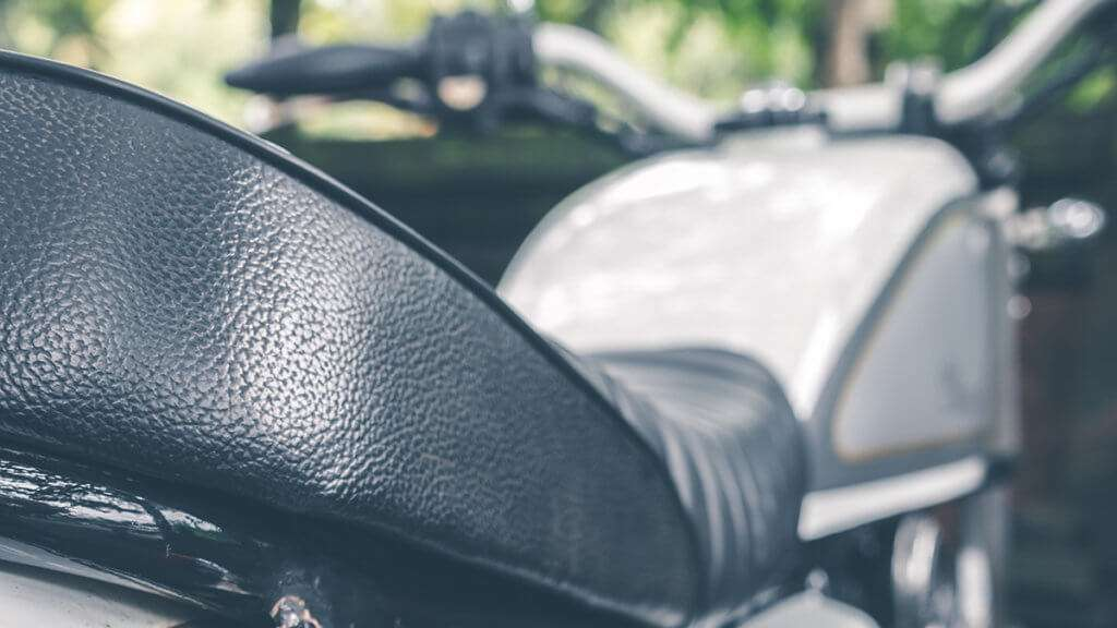 Close-up of a black motorcycle seat