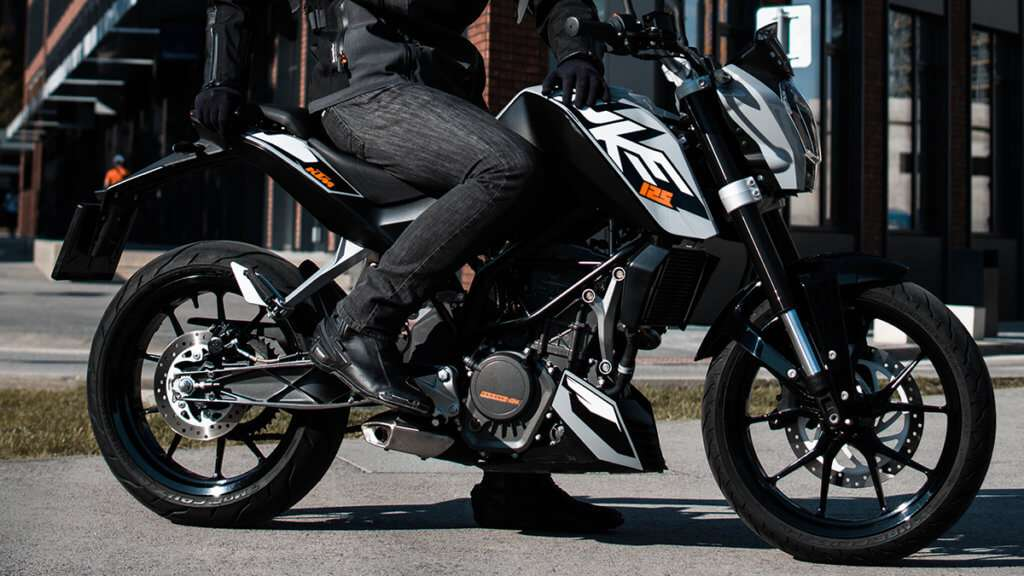 Black motorcycle boots on a KTM motorcycle