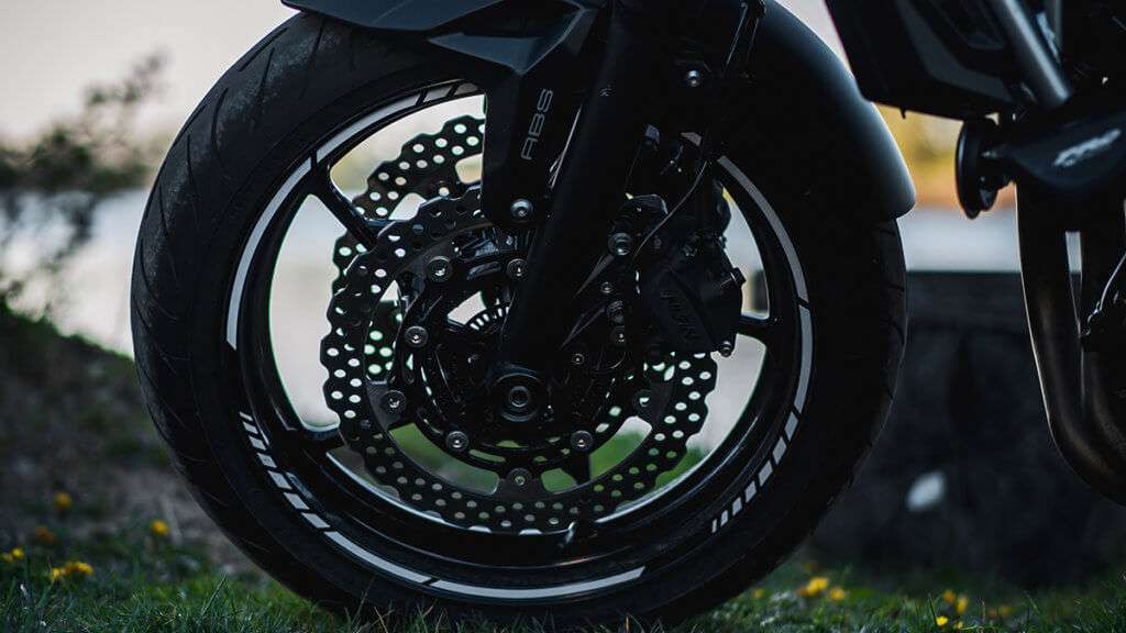 Front motorcycle tire on a black motorcycle