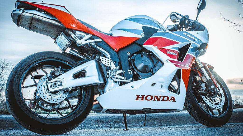 A white and red Honda CBR from the ground level
