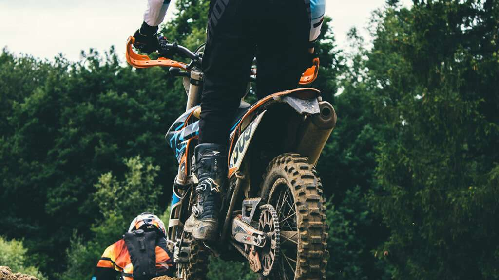 Man riding motocross standing up