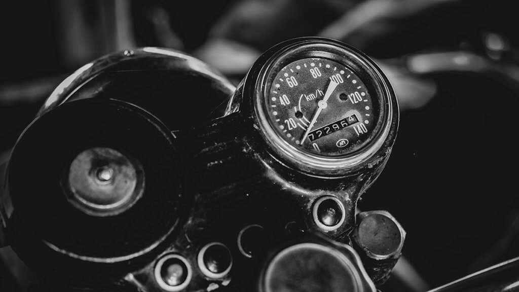 Black and white close-up of a motorcycle speedometer