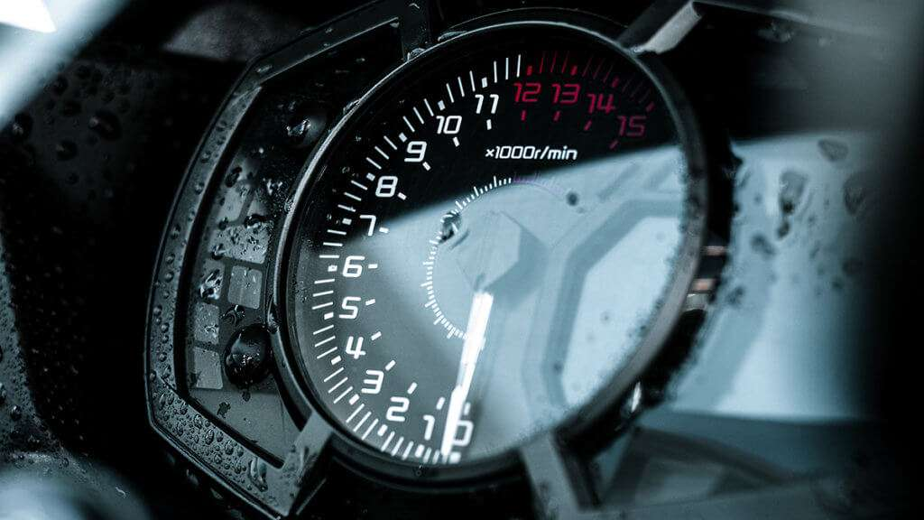 Close-up of a motorcycle tachometer a bit wet