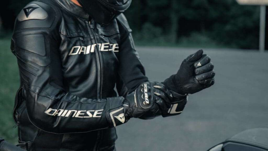 Man in black leather Dainese motorcycle jacker