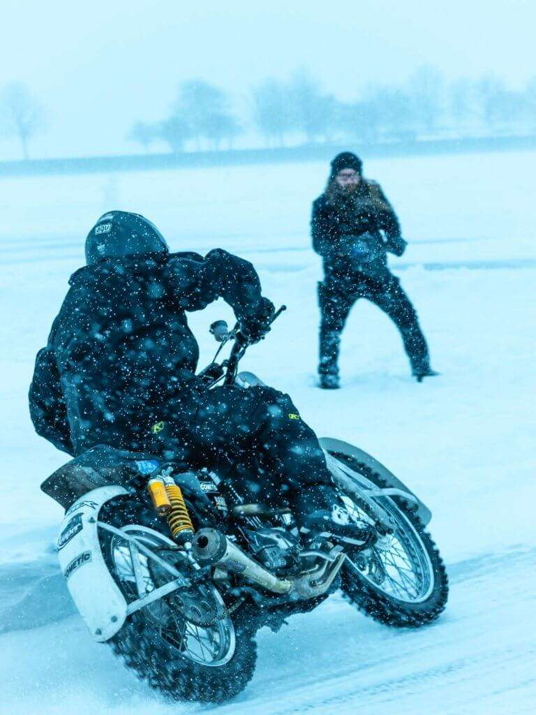 Person riding a motorcycle in the snow
