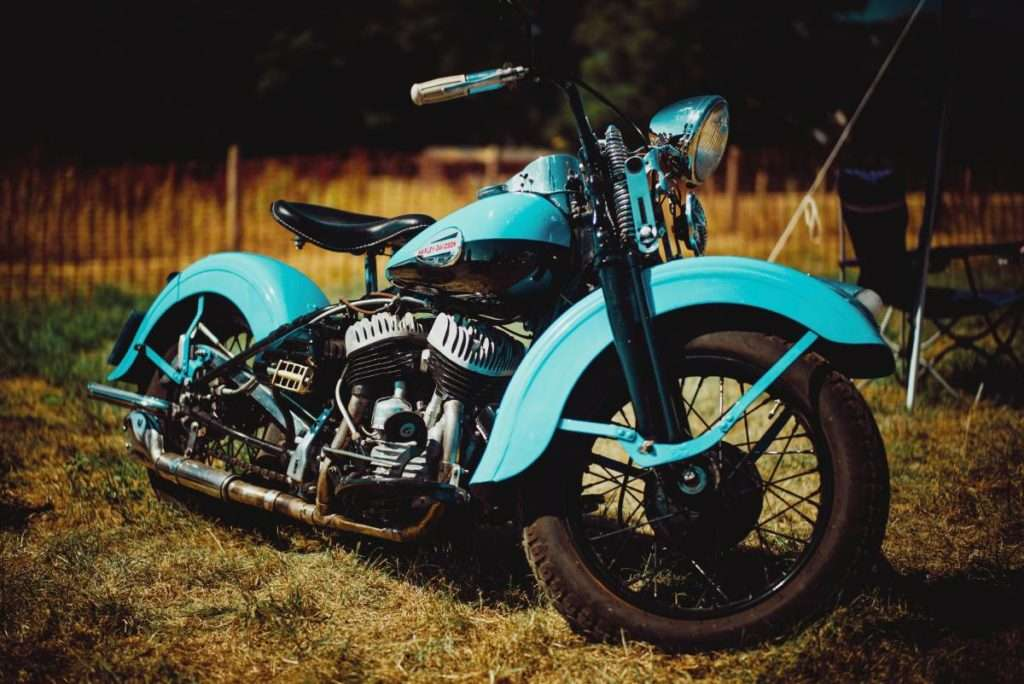 An old blue motorcycle