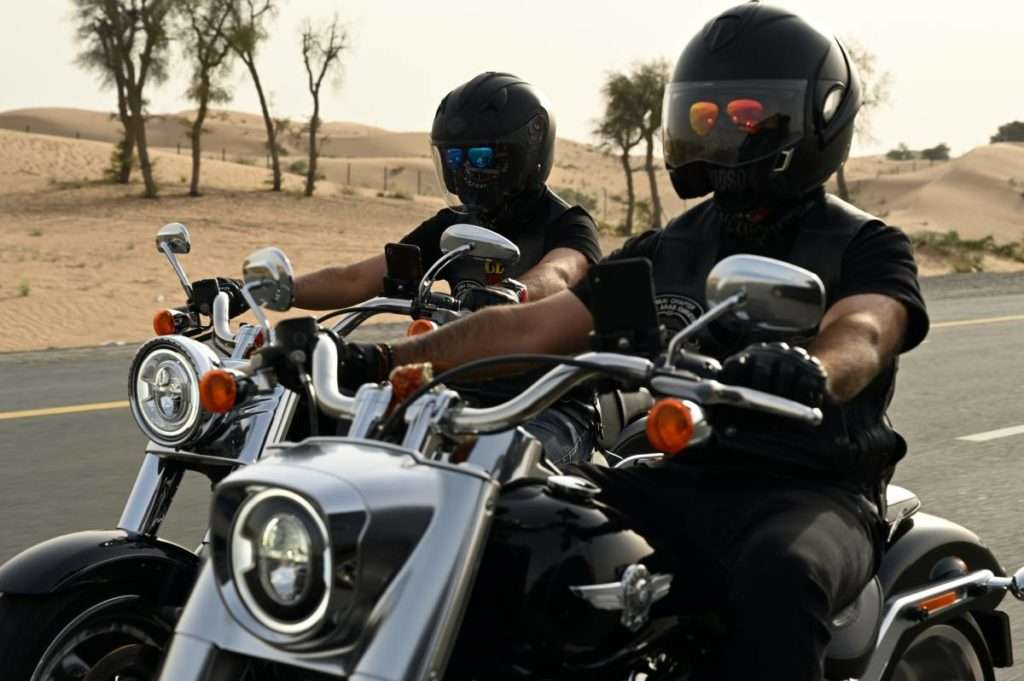 Two motorcycle riders side by side