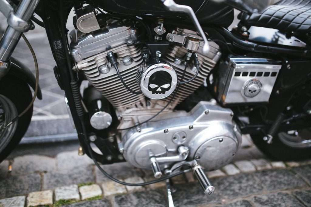 Close-up of a motorcycle engine with the punisher logo on it