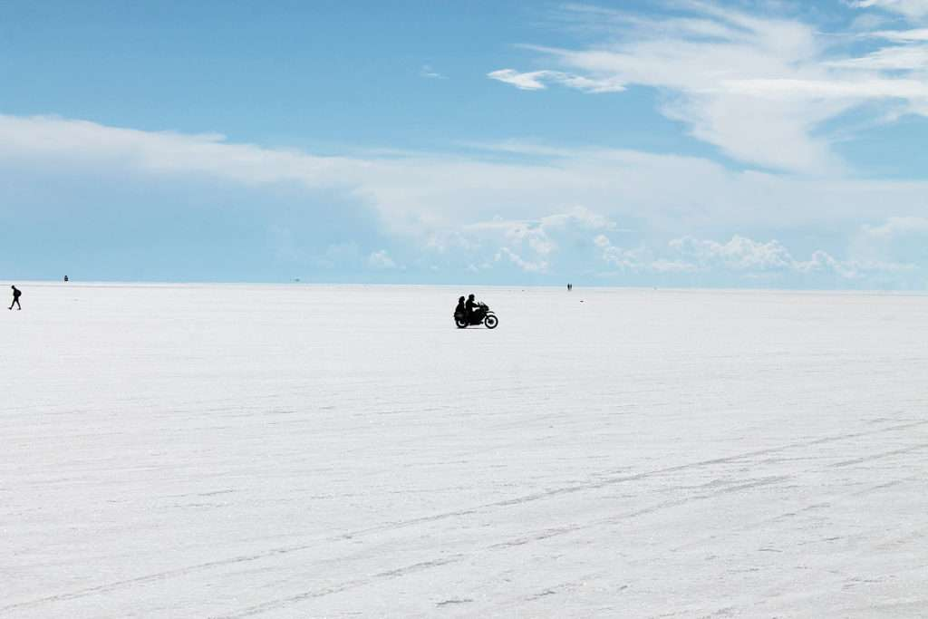Motorcycle with two riders on an ice plain