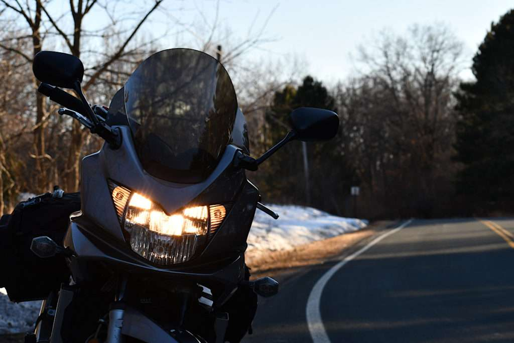 Motorcycle parked on the side of a winter road