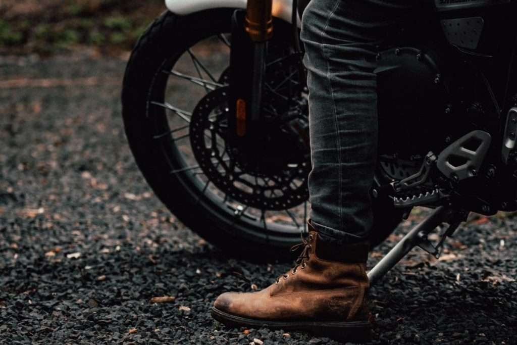 Motorcycle rider with boot on the ground
