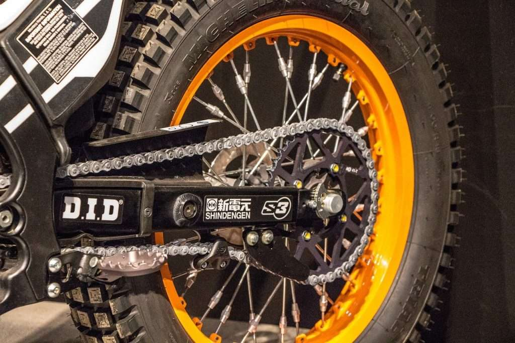 Motorcycle gear chain with an orange wheel