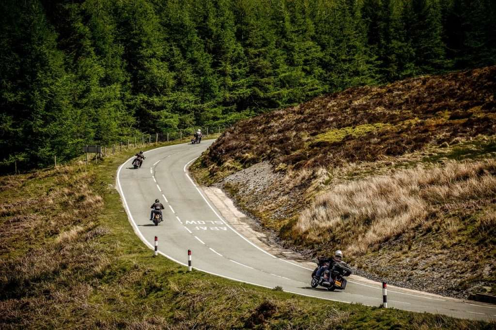 Group of motorcycle riders on a mountain road