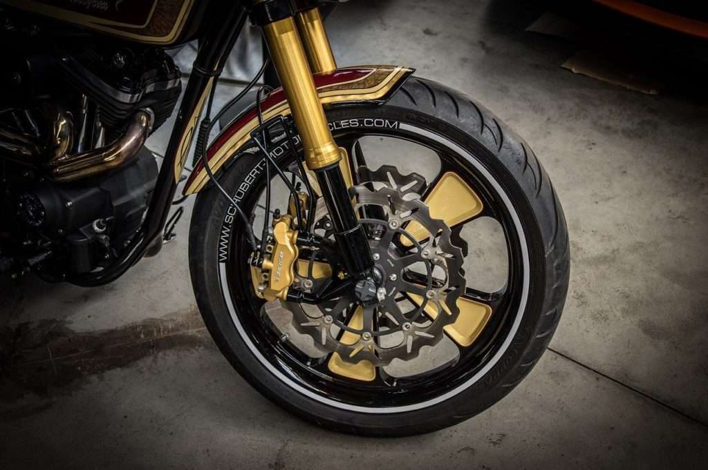 Motorcycle front wheel with suspension