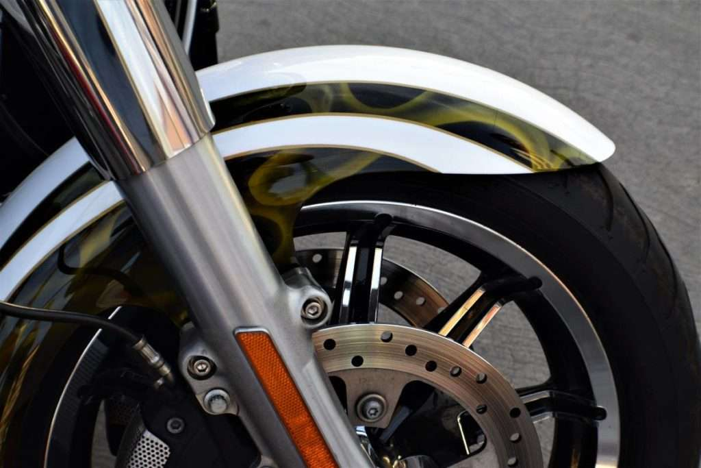 Close-up of a motorcycle front wheel and fork