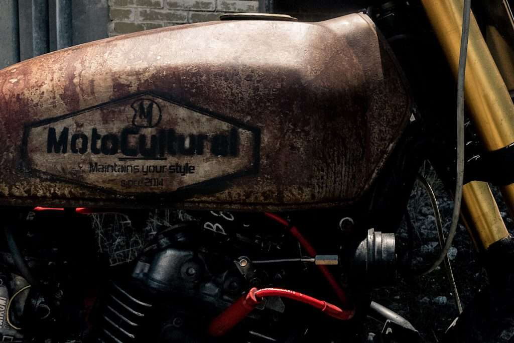 close-up of a rusty motorcycle gas tank