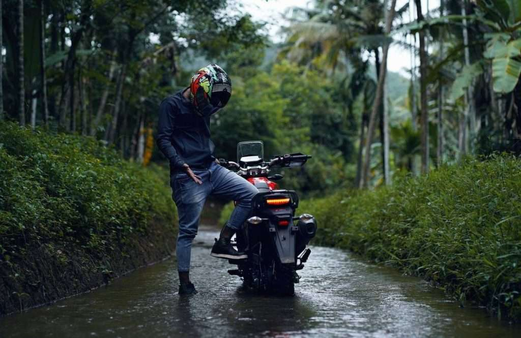 Man with motorcycle in deep water