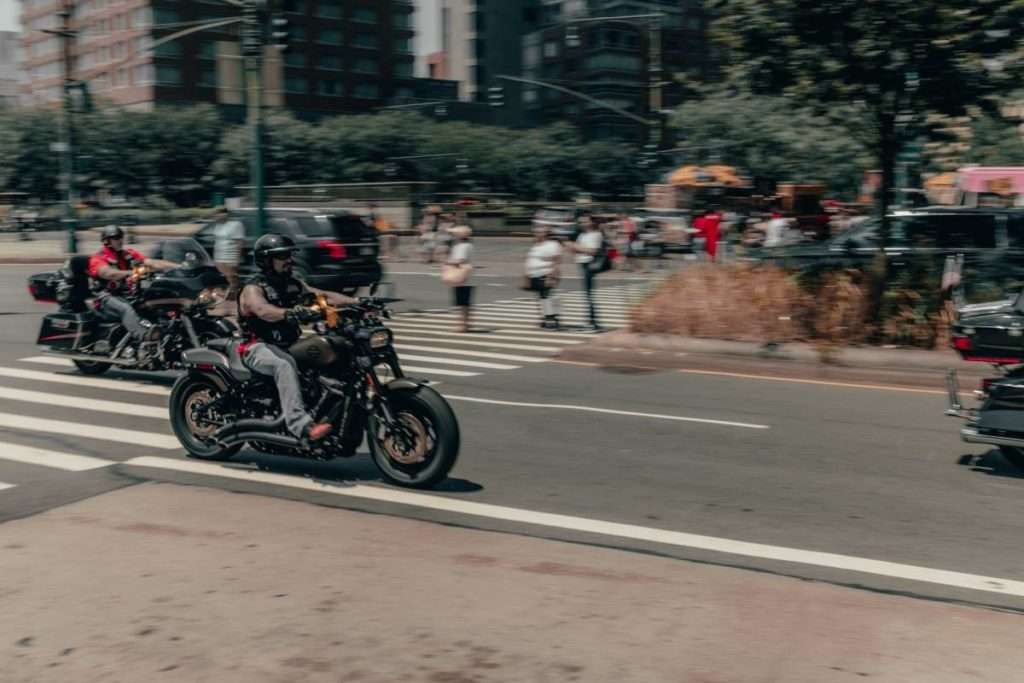 two motorcycle riders in the city