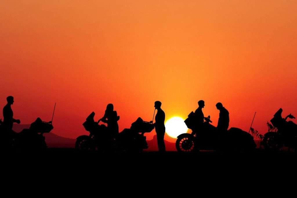 Motorcycle riders at sunset