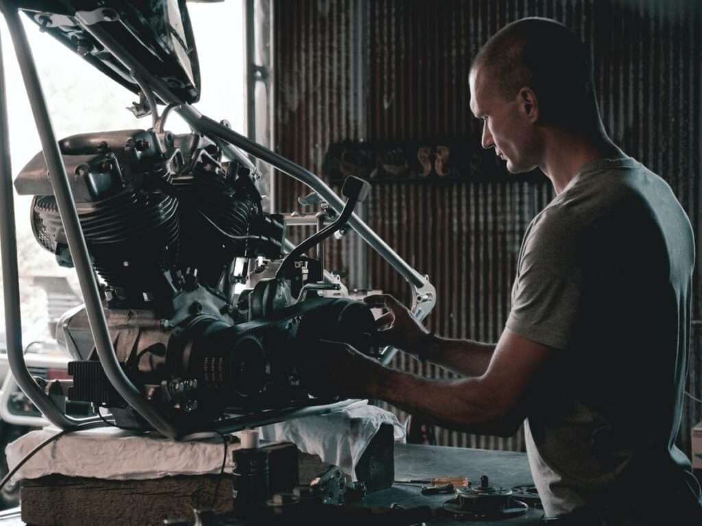 Man working on a motorcycle engine
