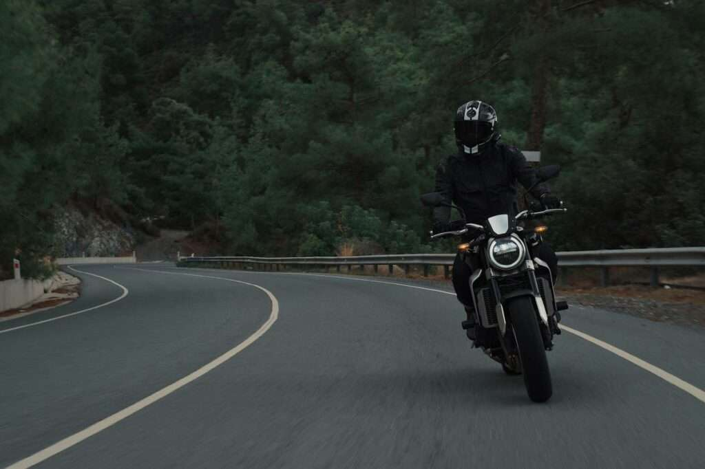 Motorcycle rider alone on the road