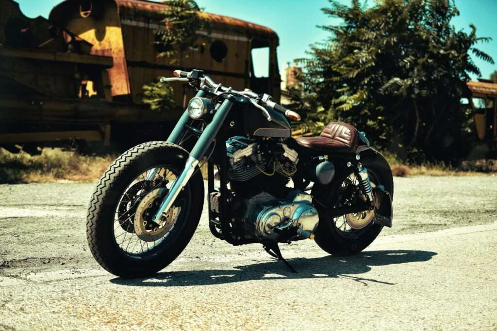 black and brown bobber motorcycle