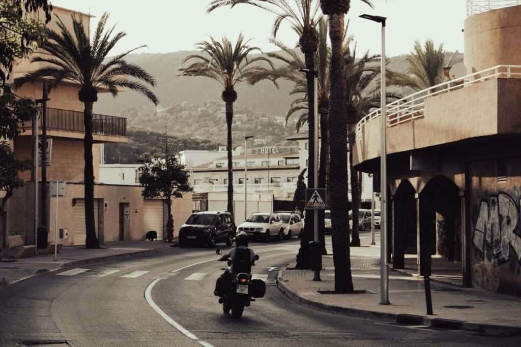 Cinematic photo of a motorcycle riding down a road