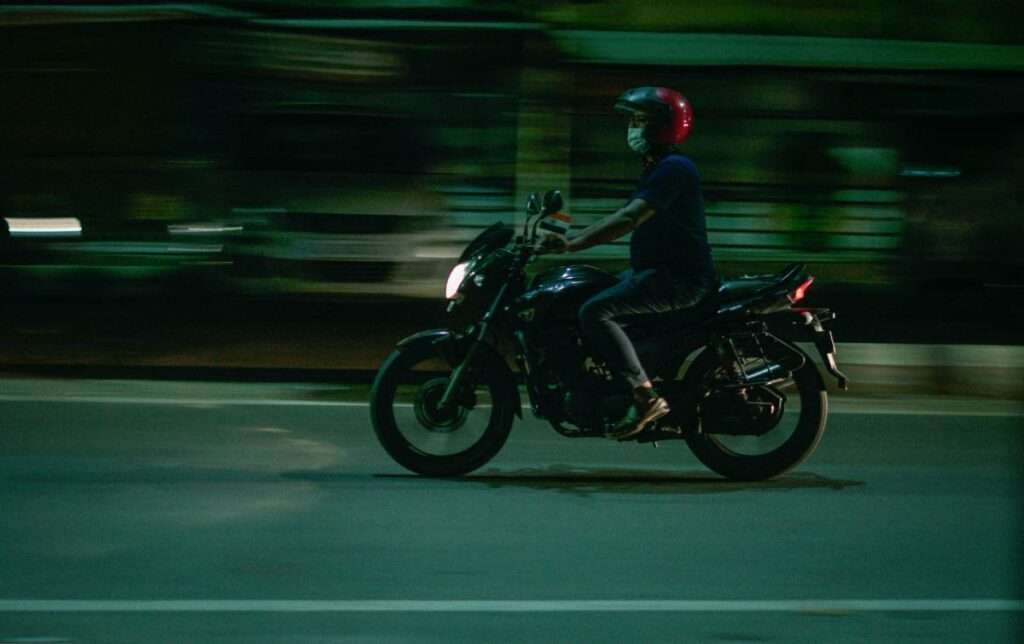 Person riding a motorcycle at night